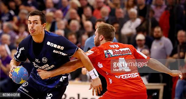 Rasmus Lauge of Flensburg challenges Christoph Foth of BalingenWeilstetten for the ball during the DKB HBL Bundesliga match between SG...