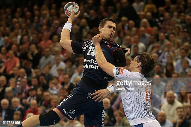 Rasmus Lauge of Flensburg is challenged by Jure Dolenec of Montpellier during the Velux EHF Champions League round of 16 second leg match between SG...
