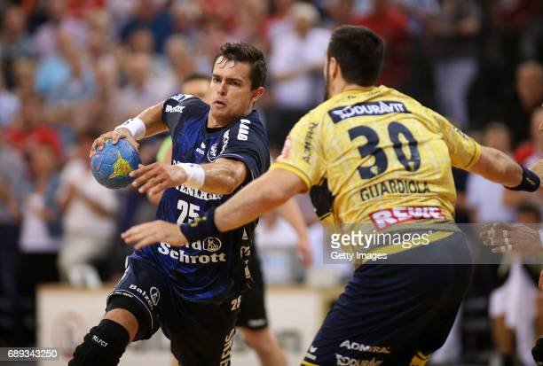 Rasmus Lauge of SG Flensburg Handewitt fights for the ball with Gedeon Guardiola during the Game SG Flensburg Handewitt v Rhein Neckar Loewen at...
