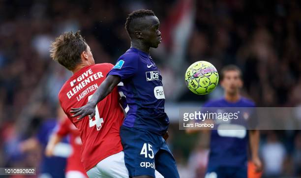 Rasmus Lauritsen of Vejle Boldklub and Awer Mabil of FC Midtjylland compete for the ball during the Danish Superliga match between Vejle Boldklub and...