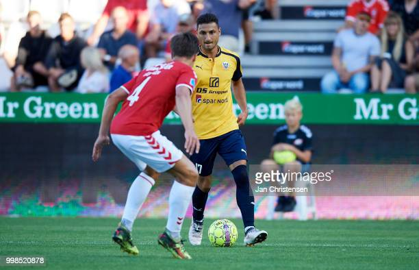 Rasmus Lauritsen of Vejle Boldklub and Edgar Babayan of Hobro IK in action during the Danish Superliga match between Vejle Boldklub and Hobro IK at...
