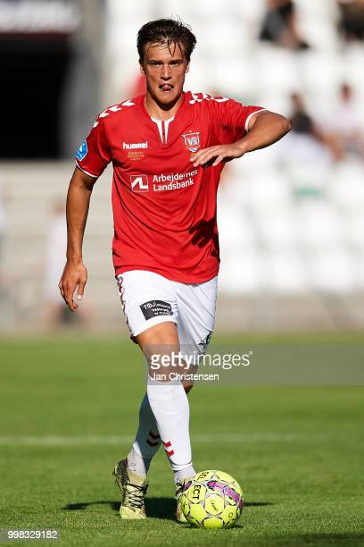Rasmus Lauritsen of Vejle Boldklub controls the ball during the Danish Superliga match between Vejle Boldklub and Hobro IK at Vejle Stadion on July...