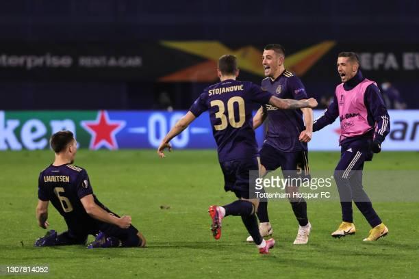 Rasmus Lauritsen, Petar Stojanovic and Arijan Ademi of GNK Dinamo Zagreb celebrate victory following the UEFA Europa League Round of 16 Second Leg...