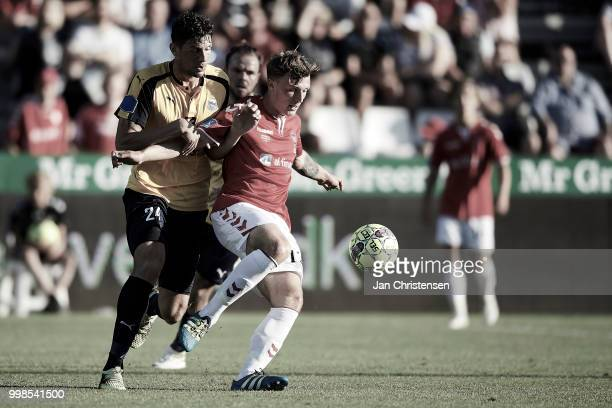 Rasmus Minor Petersen of Hobro IK and Adam Jakobsen of Vejle Boldklub compete for the ball during the Danish Superliga match between Vejle Boldklub...
