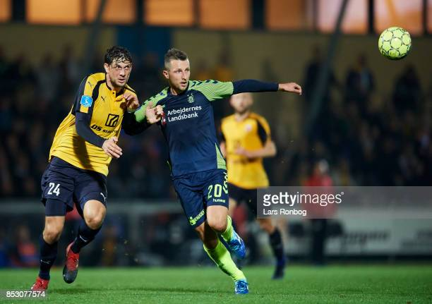 Rasmus Minor Petersen of Hobro IK and Kamil Wilczek of Brondby IF compete for the ball during the Danish Alka Superliga match between Hobro IK and...
