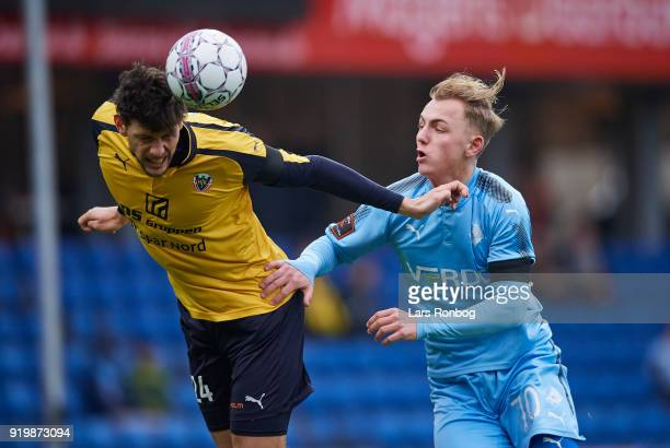 Rasmus Minor Petersen of Hobro IK and Marcus Molvadgaard of Randers FC compete for the ball during the Danish Alka Superliga match between Randers FC...
