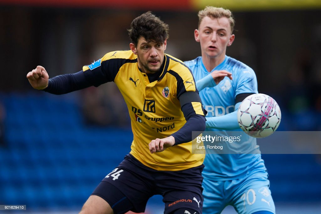 Rasmus Minor Petersen of Hobro IK and Marcus Molvadgaard of Randers FC compete for the ball during the Danish Alka Superliga match between Randers FC and Hobro IK at BioNutria Park on February 18, 2018 in Randers, Denmark.