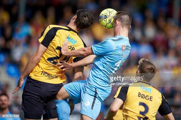 Rasmus Minor Petersen of Hobro IK and Marvin Pourié of Randers FC heading the ball during the Danish Alka Superliga match between Hobro IK and...