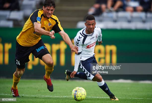 Rasmus Minor Petersen of Hobro IK and Tobias Sana of AGF Aarhus compete for the ball during the Danish Alka Superliga match between AGF Aarhus and...