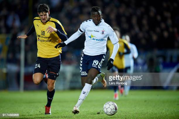 Rasmus Minor Petersen of Hobro IK chasing Mustapha Bundu of AGF Aarhus during the Danish Alka Superliga match between Hobro IK and AGF Aarhus at DS...