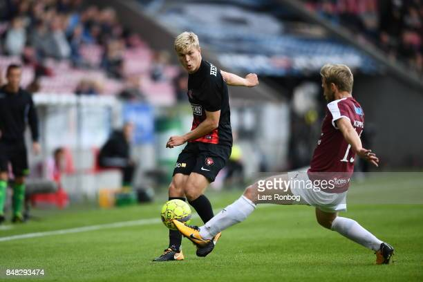 Rasmus Nissen of FC Midtjylland and Bjorn Kopplin of Hobro IK compete for the ball during the Danish Alka Superliga match between FC Midtjylland and...