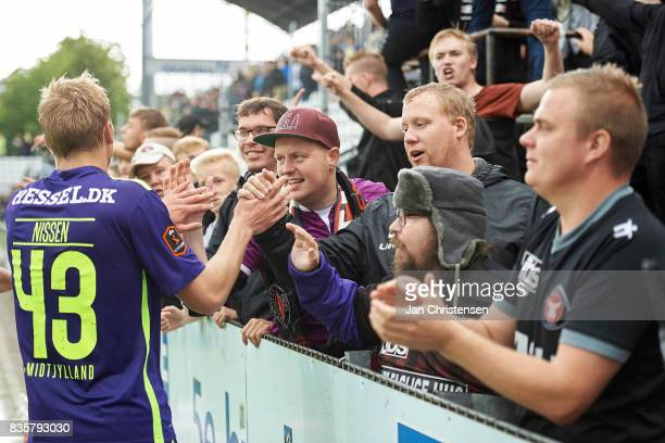 Rasmus Nissen of FC Midtjylland and fans celebrate after the Danish Alka Superliga match between OB Odense and FC Midtjylland at TREFOR Park on...