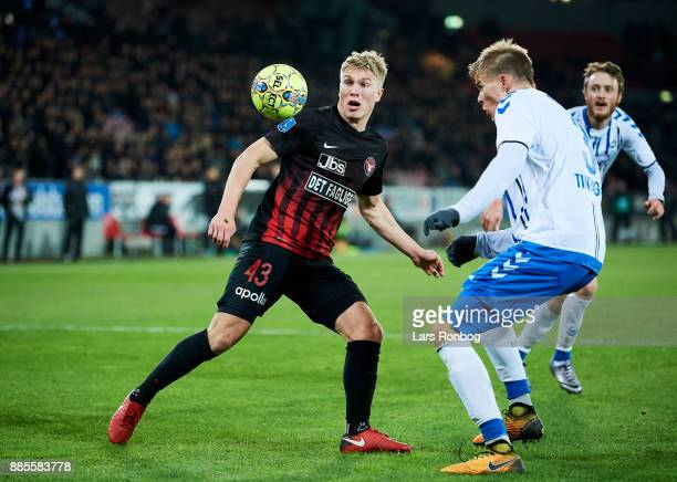 Rasmus Nissen of FC Midtjylland and Frederik Tingager of OB Odense compete for the ball during the Danish Alka Superliga match between FC Midtjylland...