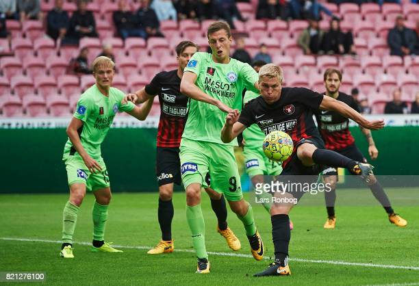 Rasmus Nissen of FC Midtjylland and Gustaf Nilsson of Silkeborg IF compete for the ball during the Danish Alka Superliga match between FC Midtjylland...