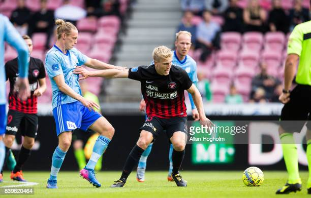 Rasmus Nissen of FC Midtjylland and Jesper Christjansen of Lyngby BK compete for the ball during the Danish Alka Superliga match between FC...