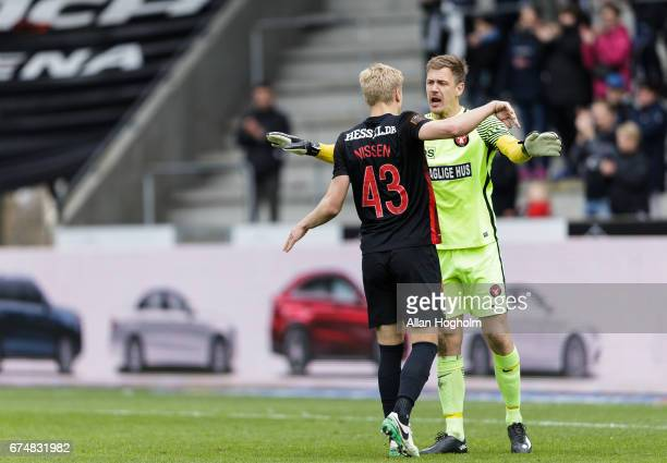 Rasmus Nissen of FC Midtjylland and Johan Dahlin of FC Midtjylland celebrates their victory after the Danish Alka Superliga match between FC...