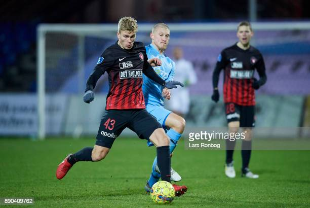 Rasmus Nissen of FC Midtjylland and Joni Kauko of Randers FC compete for the ball during the Danish Alka Superliga match between Randers FC and FC...