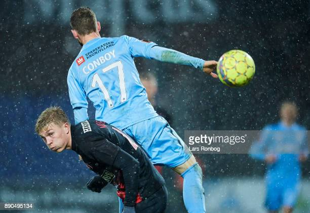 Rasmus Nissen of FC Midtjylland and Kevin Conboy of Randers FC compete for the ball during the Danish Alka Superliga match between Randers FC and FC...