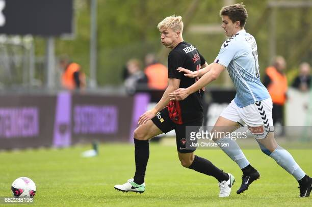 Rasmus Nissen of FC Midtjylland and Mikael Uhre of Sonderjyske compete for the ball during the Danish Alka Superliga match between SonderjyskE and FC...