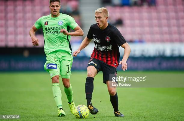 Rasmus Nissen of FC Midtjylland and Stephan Petersen of Silkeborg IF compete for the ball during the Danish Alka Superliga match between FC...
