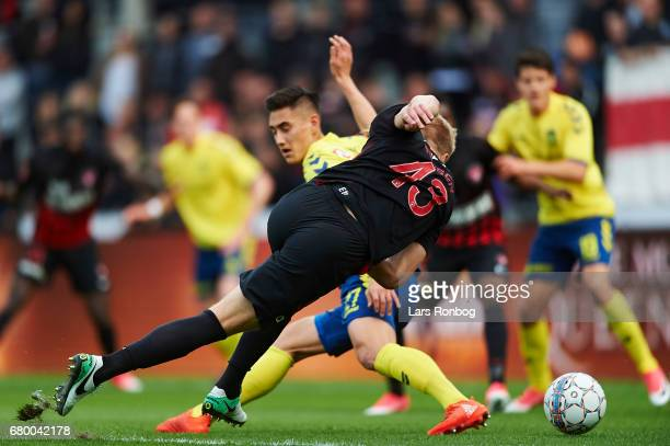 Rasmus Nissen of FC Midtjylland and Svenn Crone of Brondby IF compete for the ball during the Danish Alka Superliga match between FC Midtjylland and...