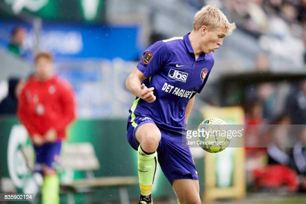 Rasmus Nissen of FC Midtjylland controls the ball during the Danish Alka Superliga match between OB Odense and FC Midtjylland at TREFOR Park on...