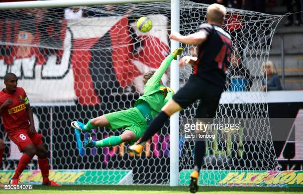 Rasmus Nissen of FC Midtjylland scores the 20 goal against Goalkeeper Runar Alex Runarsson of FC Nordsjalland durinfg the Danish Alka Superliga match...