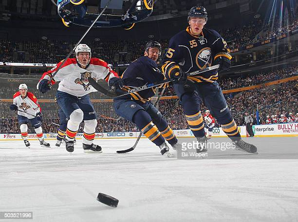 Rasmus Ristolainen and Josh Gorges of the Buffalo Sabres chase the puck while being pursued by Jaromir Jagr of the Florida Panthers during an NHL...
