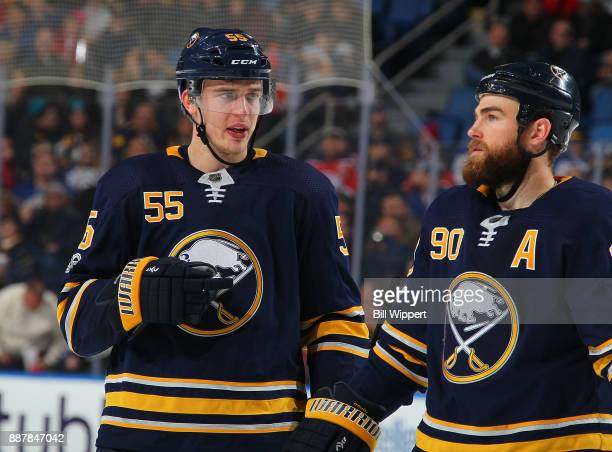 Rasmus Ristolainen and Ryan O'Reilly of the Buffalo Sabres talk during an NHL game against the Edmonton Oilers on November 24 2017 at KeyBank Center...