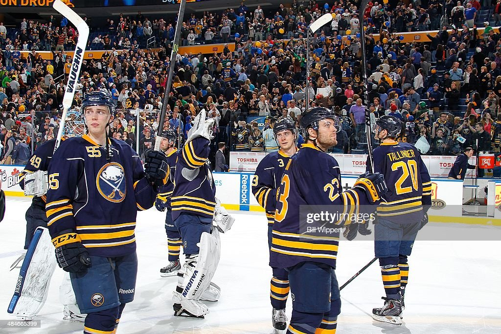 Rasmus Ristolainen #55 and Ville Leino #23 of the Buffalo Sabres salute fans following the final game of the season against the New York Islanders on April 13, 2014 at the First Niagara Center in Buffalo, New York. New York won 4-3.