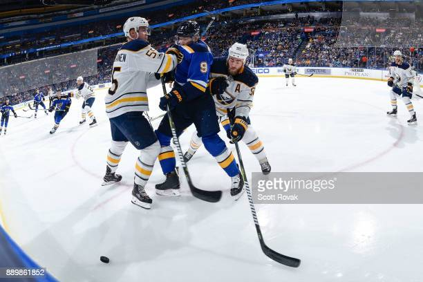 Rasmus Ristolainen of the Buffalo Sabres and Ryan O'Reilly of the Buffalo Sabres check Scottie Upshall of the St Louis Blues at Scottrade Center on...