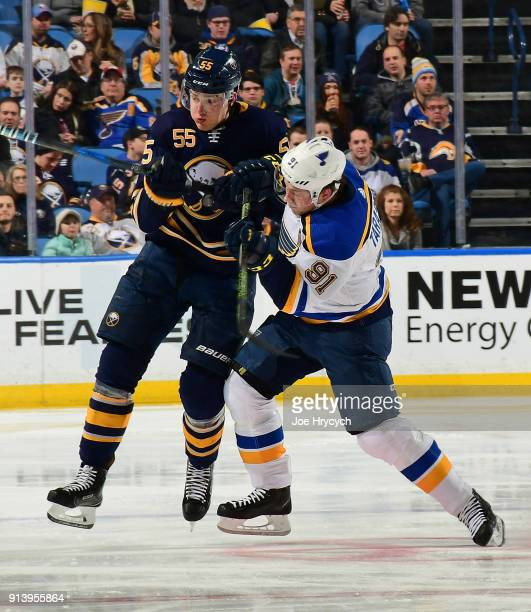 Rasmus Ristolainen of the Buffalo Sabres battles for position with Vladimir Tarasenko of the St Louis Blues during the second period of an NHL game...
