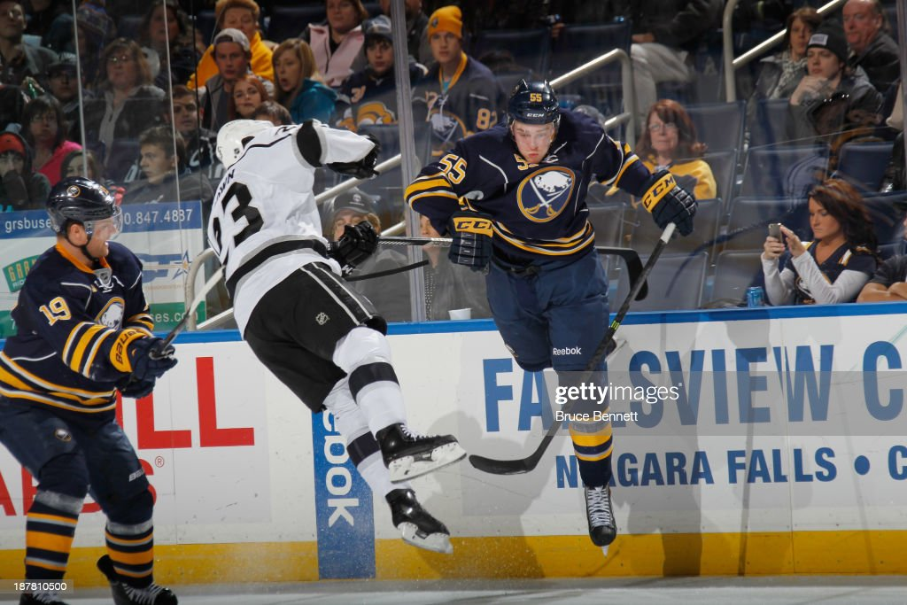 Rasmus Ristolainen #55 of the Buffalo Sabres checks Dustin Brown #23 of the Los Angeles Kings during the third period at the First Niagara Center on November 12, 2013 in Buffalo, New York. The Sabres defeated the Kings 3-2 in the shootout.