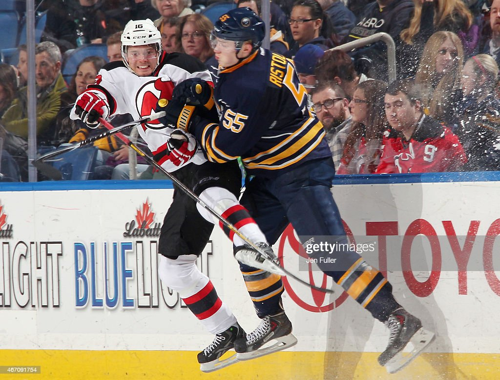 Rasmus Ristolainen of the Buffalo Sabres checks Jacob Josefson of