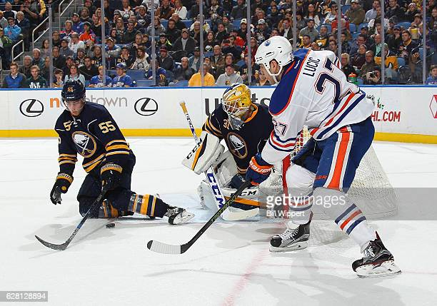Rasmus Ristolainen of the Buffalo Sabres looks to block a pass from Milan Lucic of the Edmonton Oilers in front of goaltender Anders Nilsson of the...