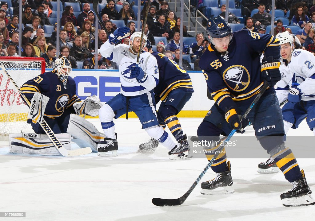 Rasmus Ristolainen #55 of the Buffalo Sabres looks to block a shot while Ryan Callahan #24 of the Tampa Bay Lightning screens Chad Johnson #31 during an NHL game on February 13, 2018 at KeyBank Center in Buffalo, New York. Buffalo won, 5-3.