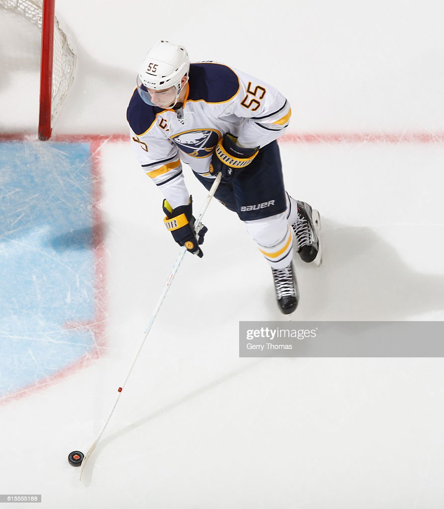 Rasmus Ristolainen #55 of the Buffalo Sabres plays the puck against the Calgary Flames at Scotiabank Saddledome on October 18, 2016 in Calgary, Alberta, Canada.