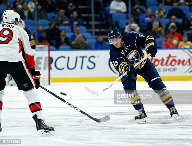 Rasmus Ristolainen of the Buffalo Sabres shoots the puck past Bobby Ryan of the Ottawa Senators during the second period at the KeyBank Center on...