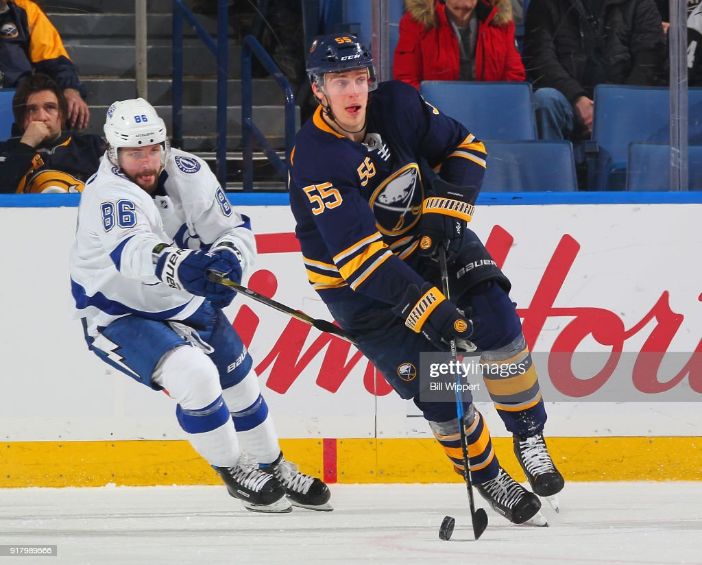 Rasmus Ristolainen #55 of the Buffalo Sabres skates with the puck against Nikita Kucherov #86 of the Tampa Bay Lightning during an NHL game on February 13, 2018 at KeyBank Center in Buffalo, New York. Buffalo won, 5-3.