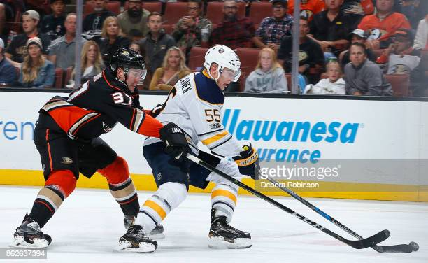 Rasmus Ristolainen of the Buffalo Sabres skates with the puck with pressure from Nick Ritchie of the Anaheim Ducks during the game on October 15 2017...