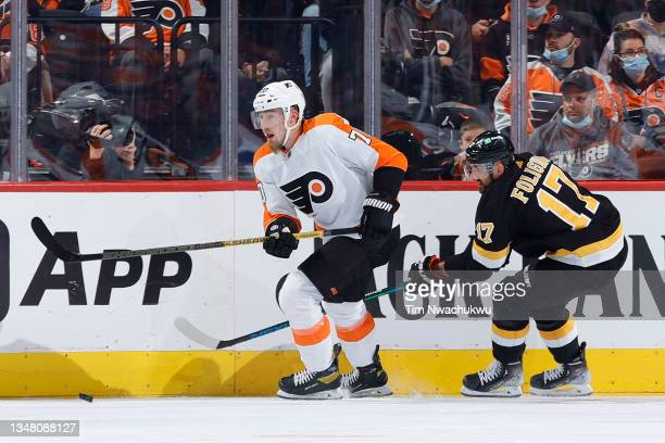 Rasmus Ristolainen of the Philadelphia Flyers and Nick Foligno of the Boston Bruins chase the puck at Wells Fargo Center on October 20, 2021 in...