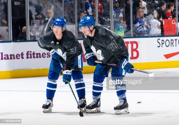 Rasmus Sandin and Adam Brooks of the Toronto Maple Leafs wears a jersey honouring the Canadian Armed Forces during warmup before facing the Chicago...
