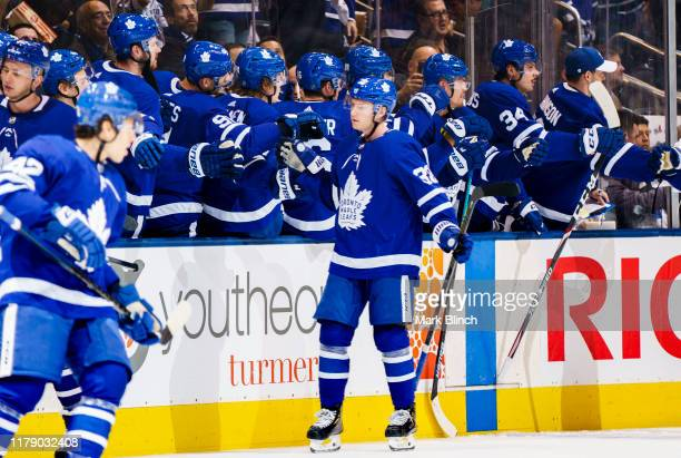 Rasmus Sandin of the Toronto Maple Leafs celebrates an assist and first NHL point with teammates against the Ottawa Senators during the second period...