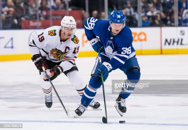 Rasmus Sandin of the Toronto Maple Leafs skates with the puck against the Chicago Blackhawks during the second period at the Scotiabank Arena on...