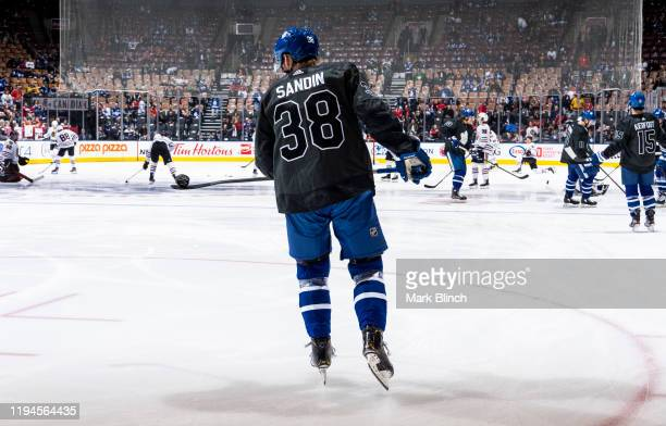 Rasmus Sandin of the Toronto Maple Leafs wears a jersey honouring the Canadian Armed Forces during warmup before facing the Chicago Blackhawks at the...