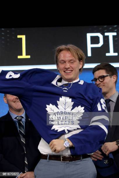 Rasmus Sandin poses after being selected twentyninth overall by the Toronto Maple Leafs during the first round of the 2018 NHL Draft at American...