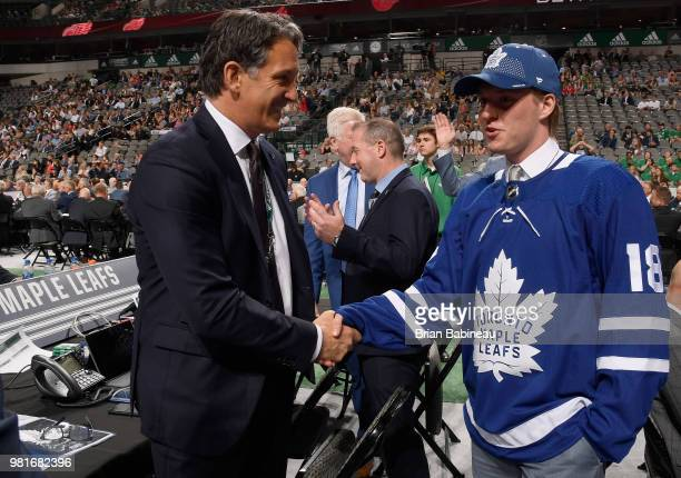 Rasmus Sandin shakes the hand of Brendan Shanahan after being selected twentyninth overall by the Toronto Maple Leafs during the first round of the...