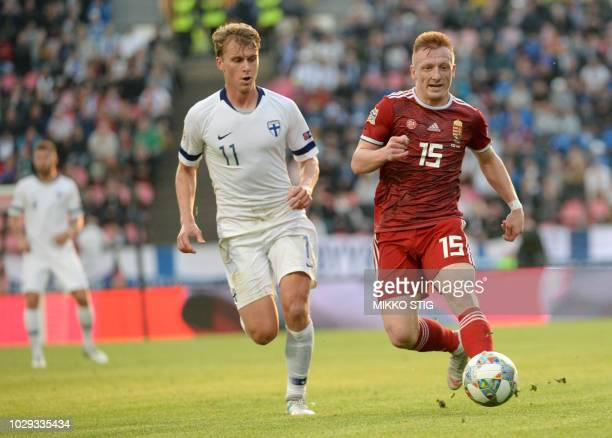 Rasmus Schuller of Finland and Laszlo Kleinheisler of Hungary vie with the ball during the UEFA Nations League football match between Finland and...