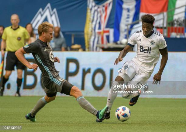 Rasmus Schuller of Minnesota United defends against Alphonso Davies of the Vancouver Whitecaps at BC Place on July 28 2018 in Vancouver Canada