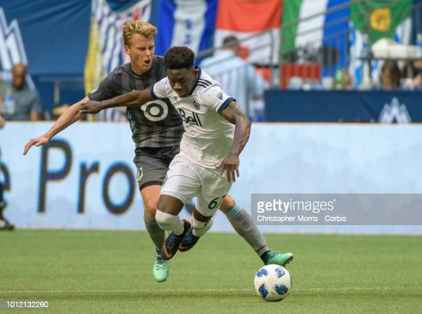 Rasmus Schuller of Minnesota United trips Alphonso Davies of the Vancouver Whitecaps at BC Place on July 28 2018 in Vancouver Canada